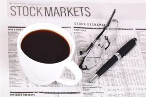 Fresh hot coffee on newspaper with Glasses and pen